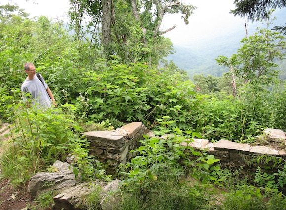 Lance at the top of stone steps leading down into a root cellar. Look at that view!